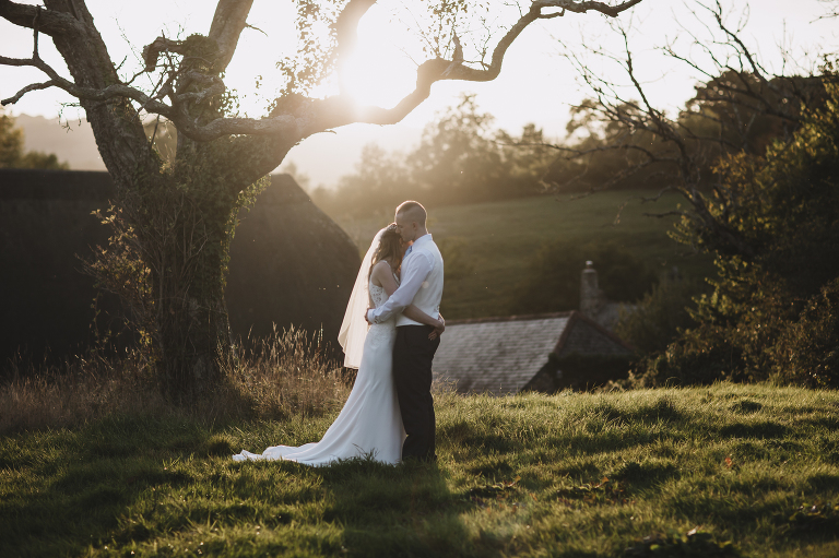 The great barn, devon, sunset couple